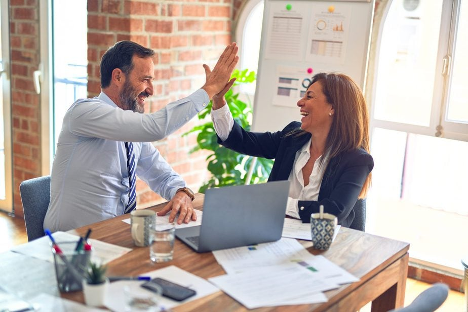 how to get clients as a freelancer man and woman high five